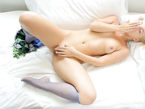Cutie In Knee Highs Masturbates Her Young Pussy