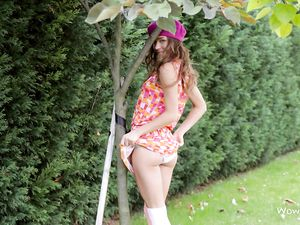 Slender Ass Flashing Teen In The Garden