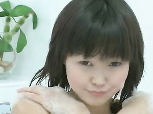 Wet Cutie In The Bathtub Rubs Her Asian Pussy