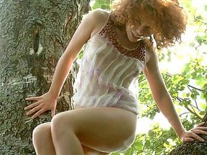 Amazing Teen Masturbating On A Tree Naked